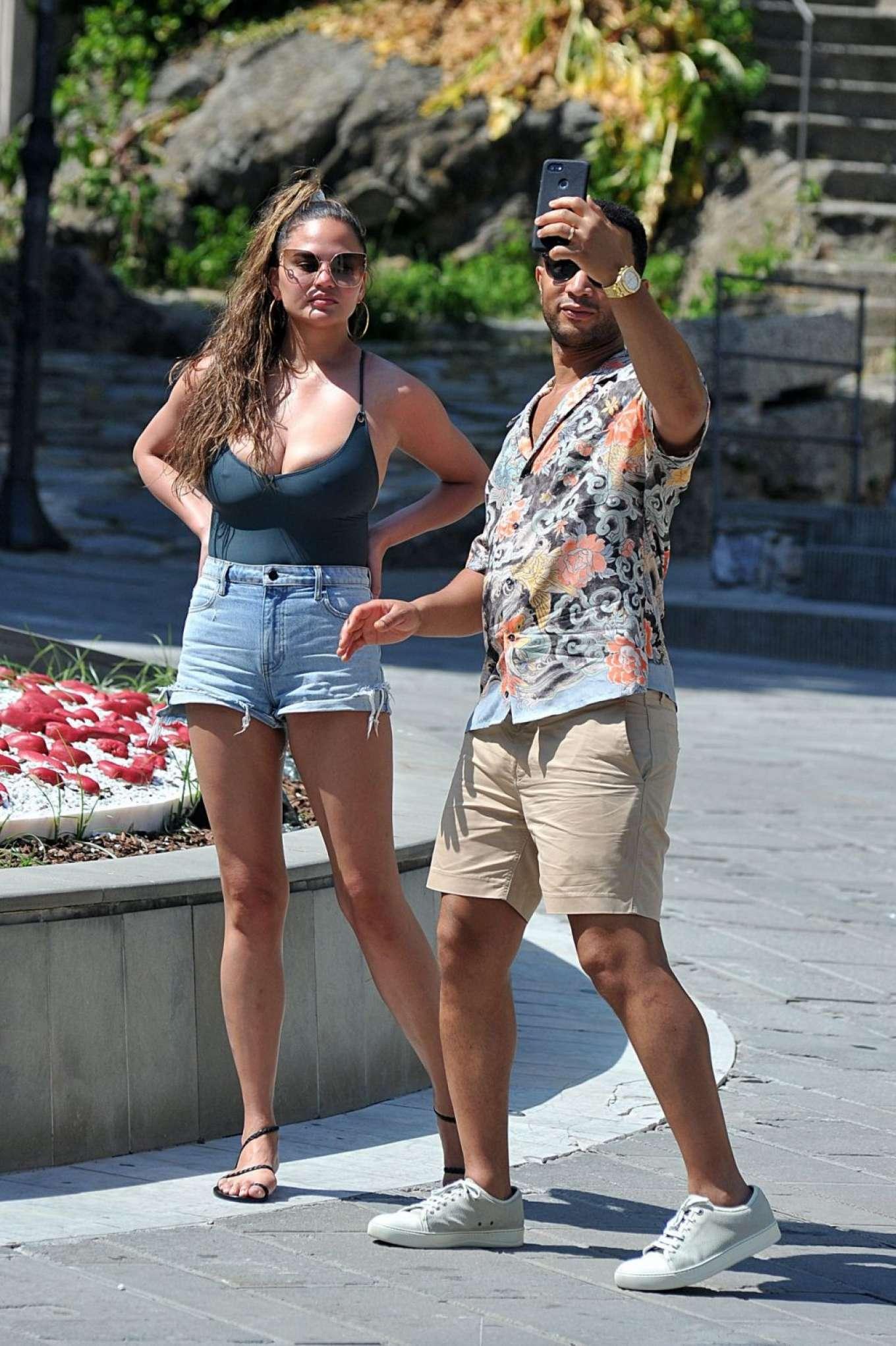 Chrissy Teigen in Denim Shorts - Out in Porto Venere