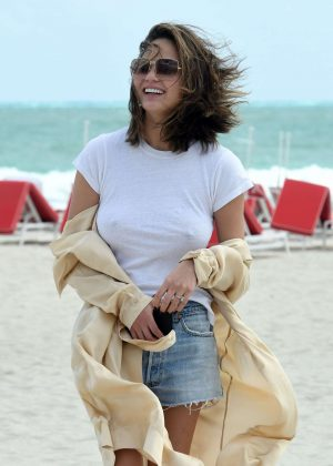 Chrissy Teigen in Jeans Shorts on the Beach in Miami
