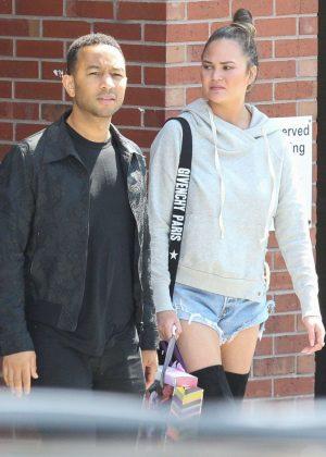 Chrissy Teigen in Jeans Shorts Out in Boston