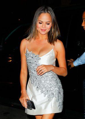 Chrissy Teigen in silver mini dress out in New York
