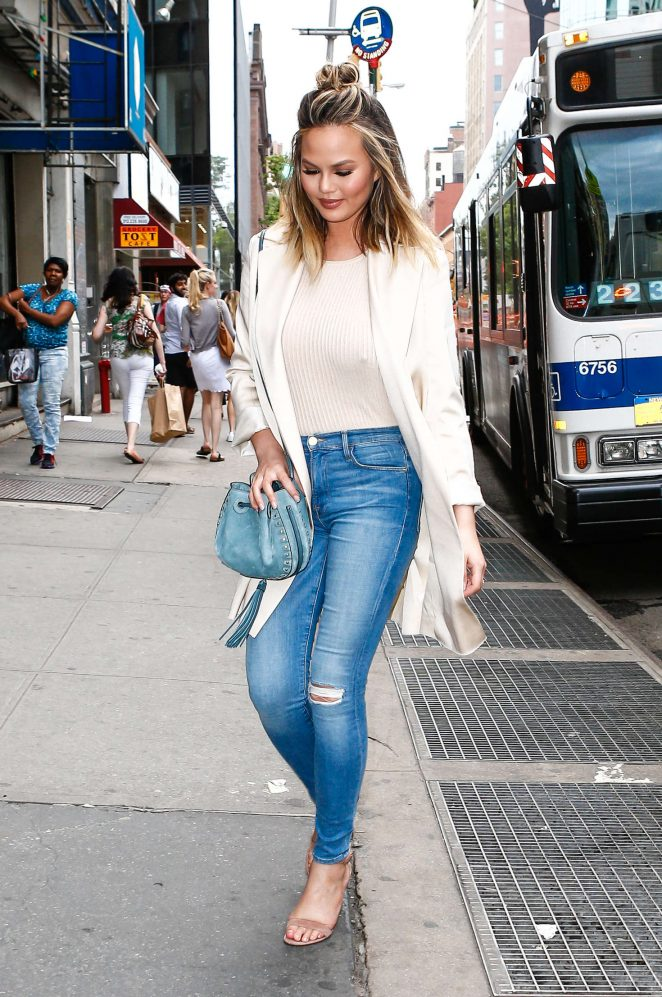 Chrissy Teigen in Skinny Ripped Jeans in NYC