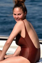 Chrissy Teigen in Swimsuit on a boat ride in Portofino
