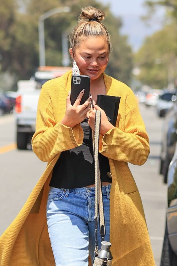 Chrissy Teigen - Is seen during a FaceTime call in Los Angeles
