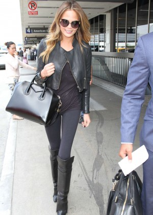 Chrissy Teigen in Tights at LAX airport in LA