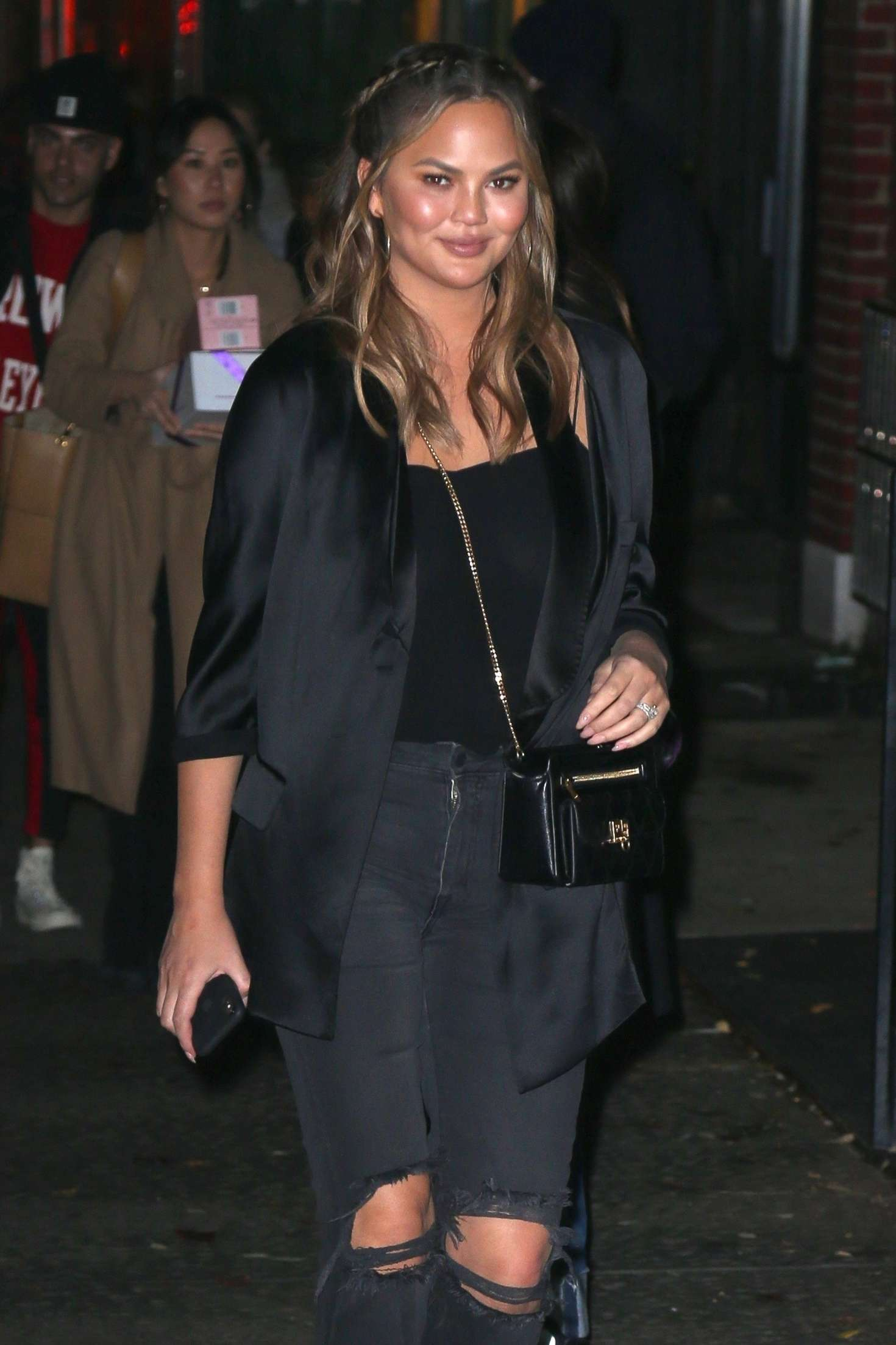 Chrissy Teigen – Leaves her apartment in New York