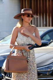 Chrissy Teigen - Leaving Meche hair salon in Beverly Hills