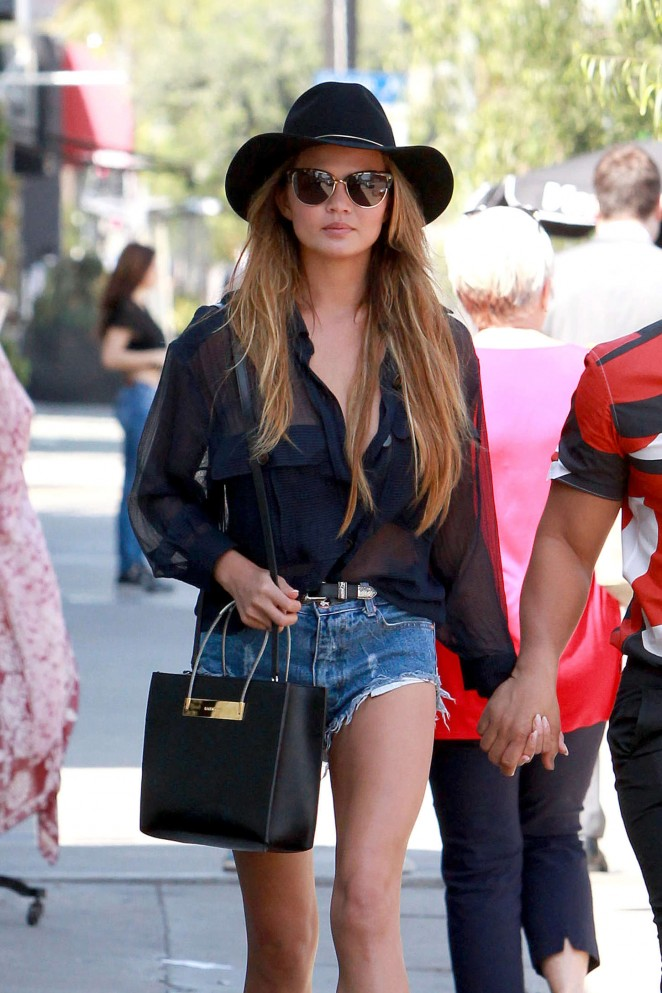 Chrissy Teigen in Denim Shorts Out in West Hollywood