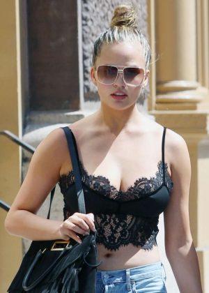 Chrissy Teigen - Wearing a lace bra top out in NYC