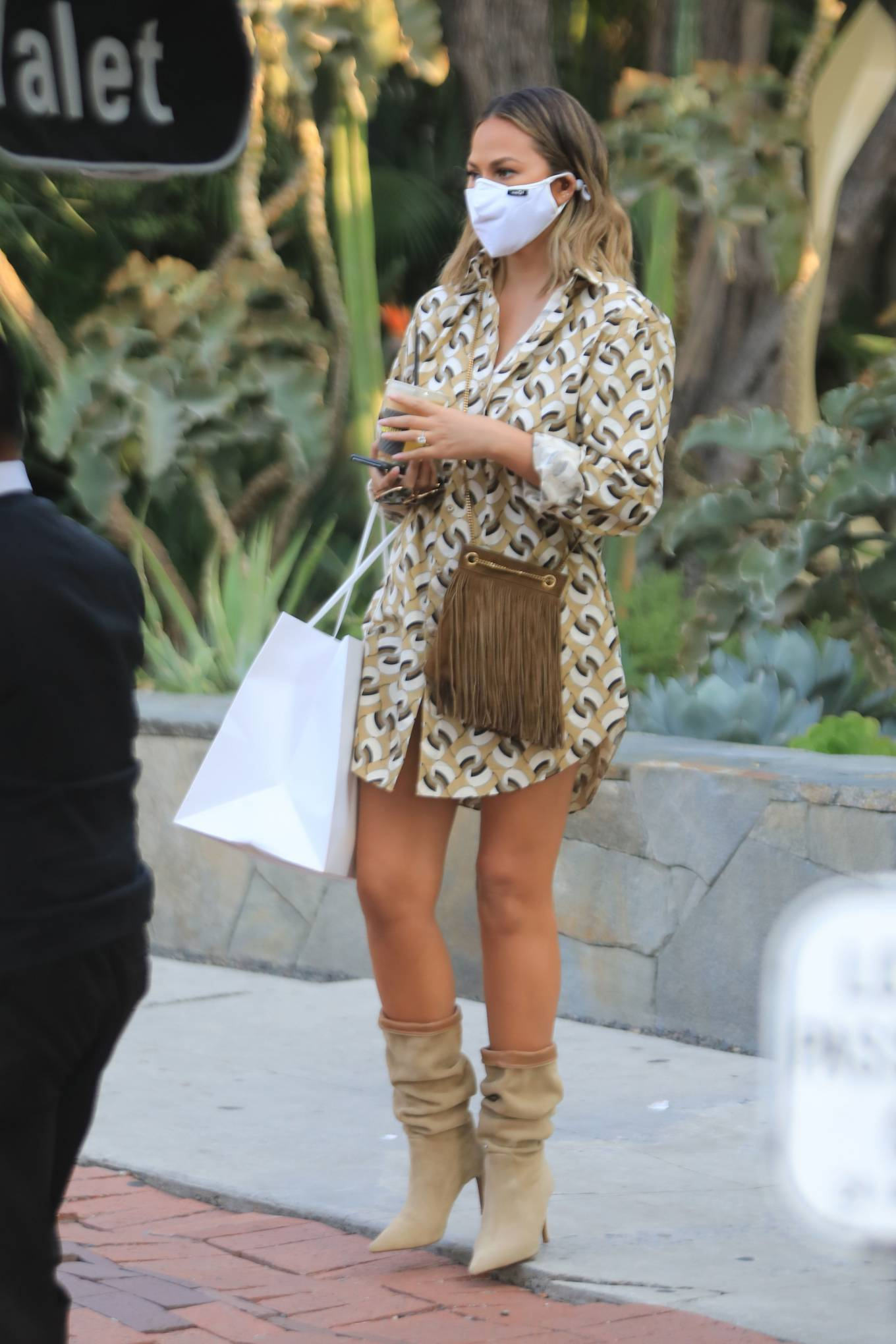 Chrissy Teigen with John Legend - Shopping candids on Melrose place