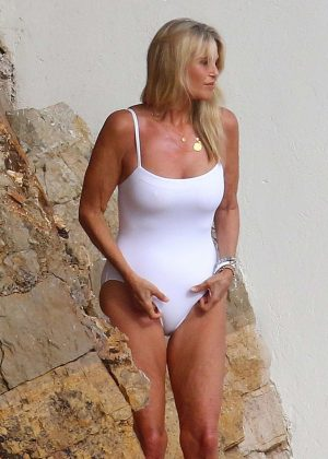 Christie Brinkley in White Swimsuit at Hotel Eden Roc in Antibes