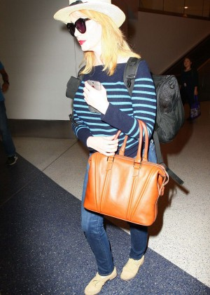 Christina Hendricks in Jeans at LAX -09
