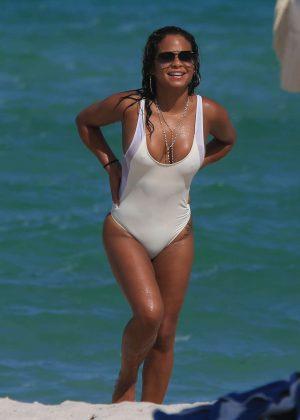 Christina Milian in White Swimsuit at the Beach in Miami