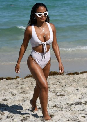 Christina Milian in White Swimsuit on the beach in Miami
