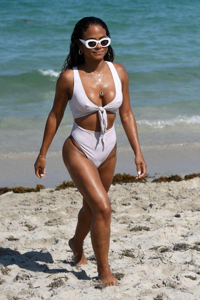 Christina Milian in White Swimsuit on the beach in Miami