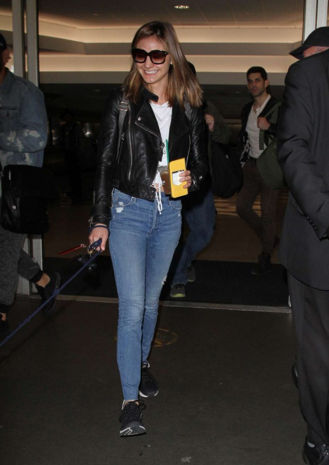 Christine Evangelista - Arrives at Los Angeles International Airport