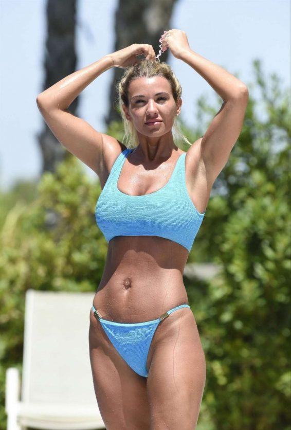 Christine McGuinness in Blue Bikini on the pool in Spain