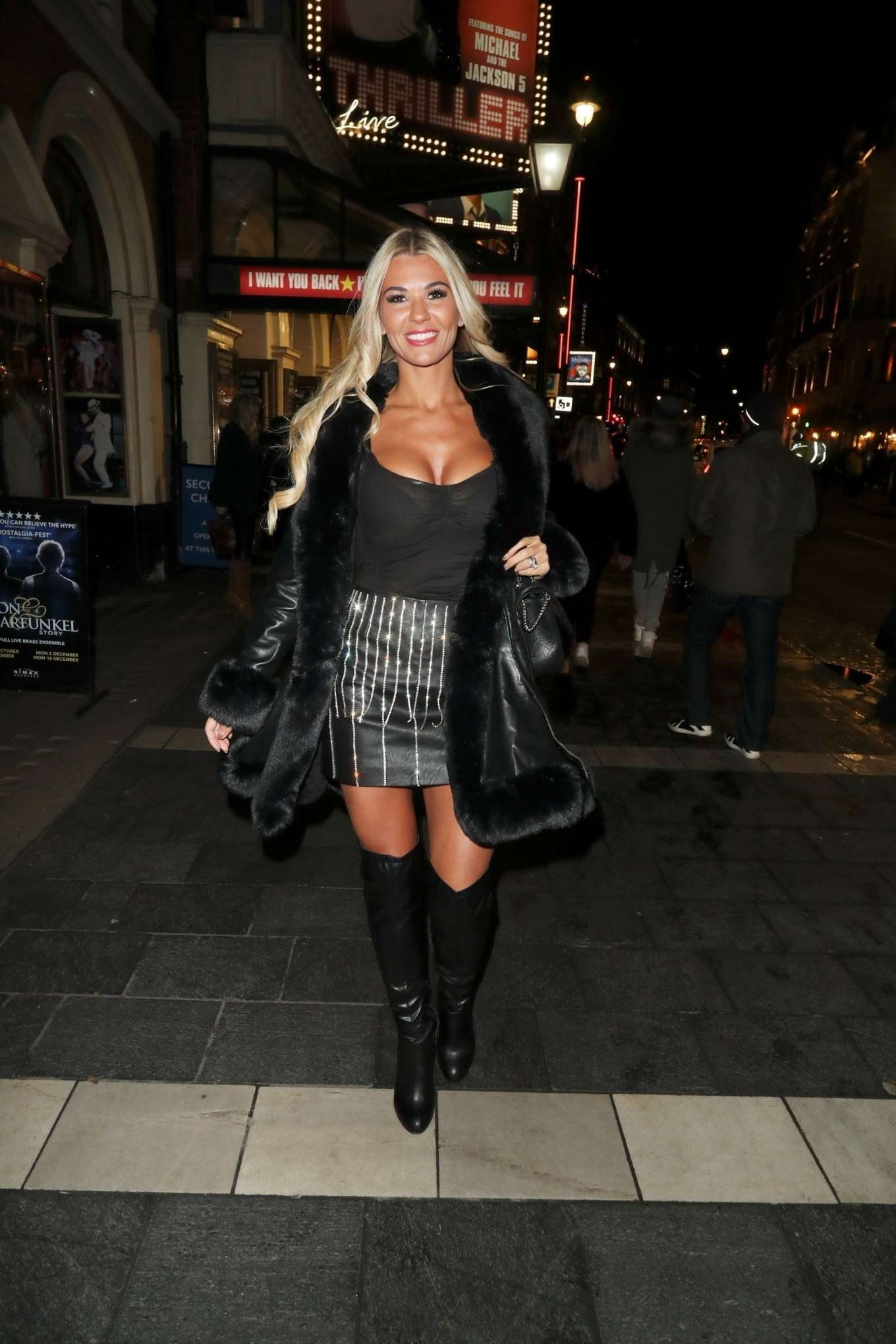 Christine McGuinness in Mini Skirt and Knee High Boots - Out in London