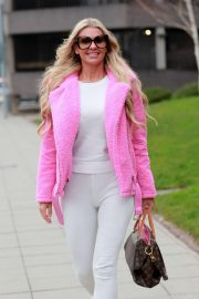 Christine McGuinness in Pink Jacket - Arrives at Manchester Airport