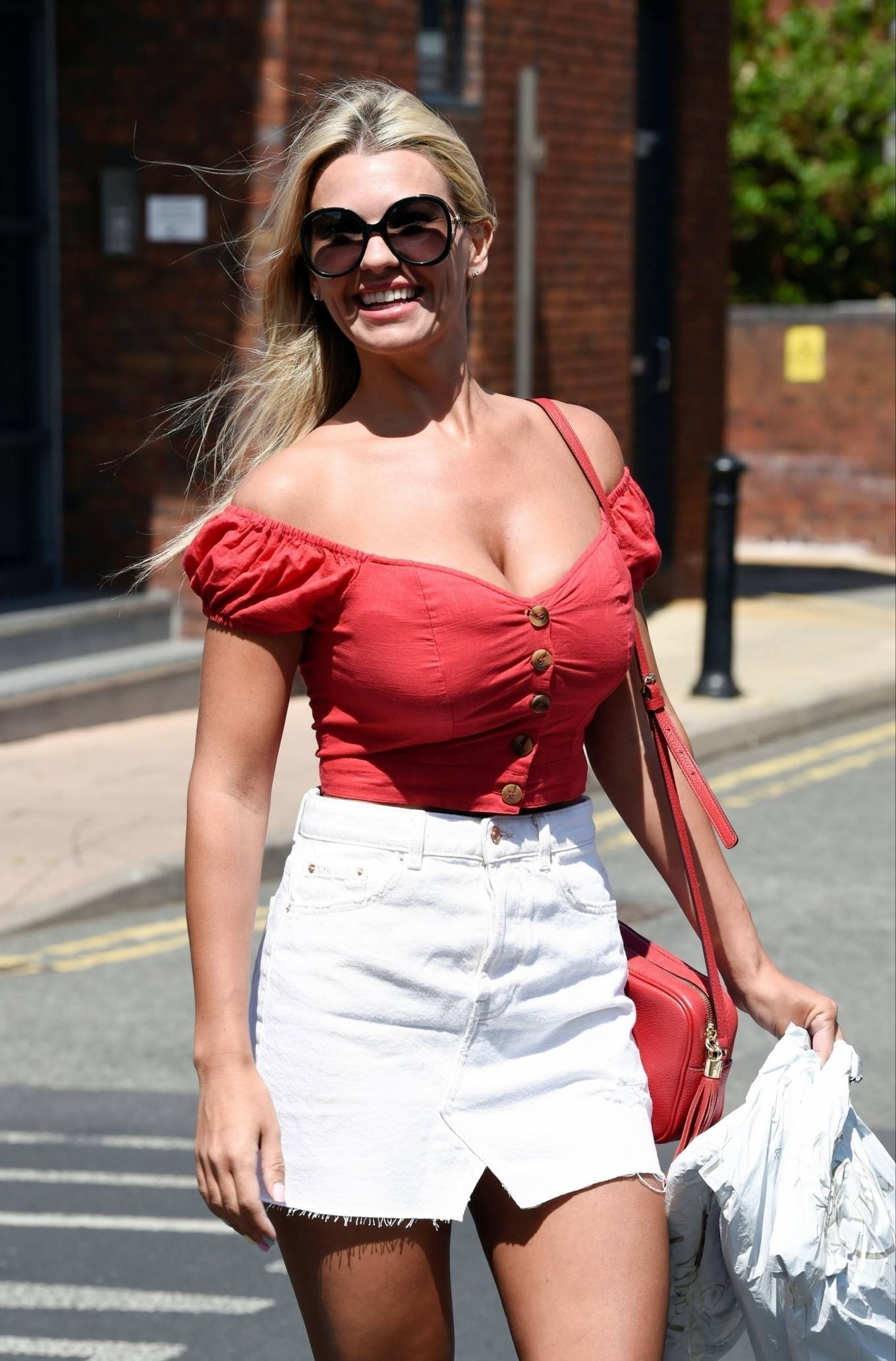 Christine McGuinness in White Mini Skirt - Outside a post office in Wilmslow