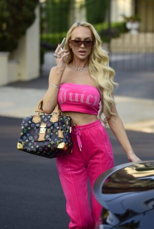 Christine Quinn - Seen in a bright pink tracksuit on set filming a commercial in Beverly Hills