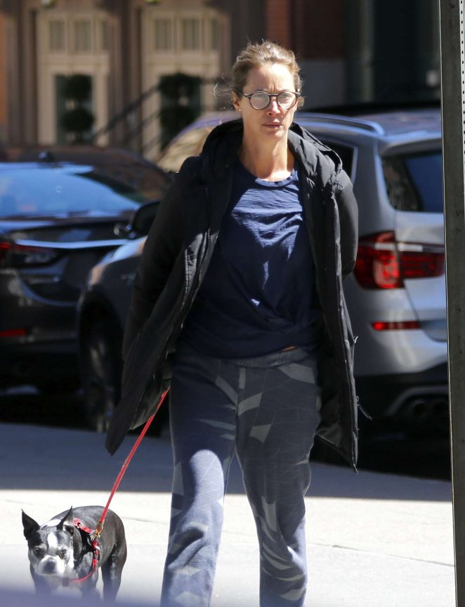 Christy Turlington walking with her french bulldog in Tribeca