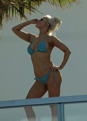 CJ Perry Lana in Blue Bikini on a balcony in Miami