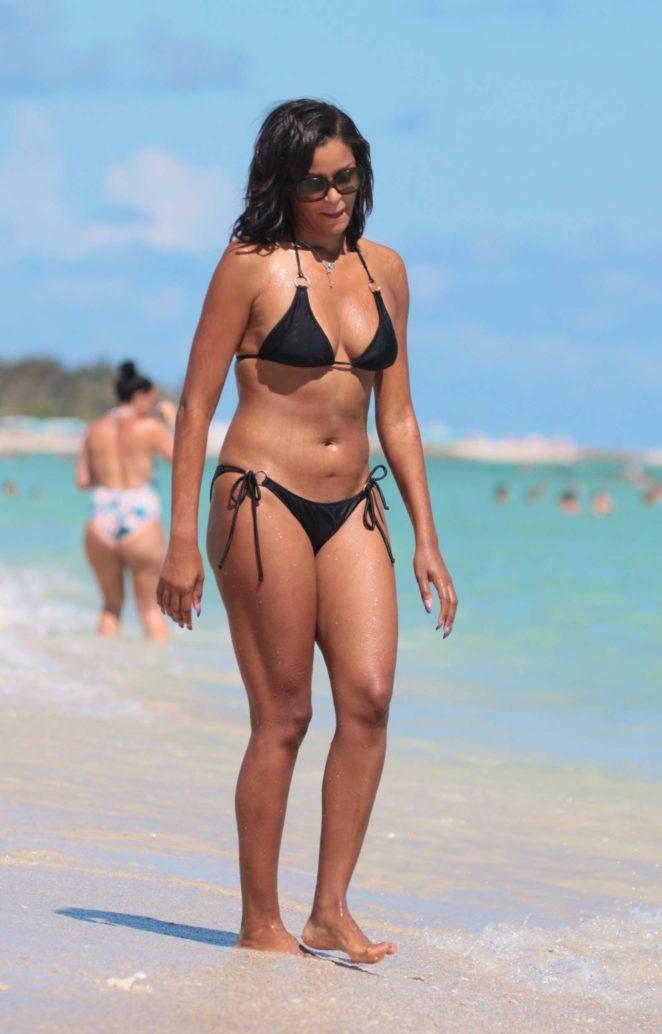 Claudia Jordan in Black Bikini at the beach in Miami Beach