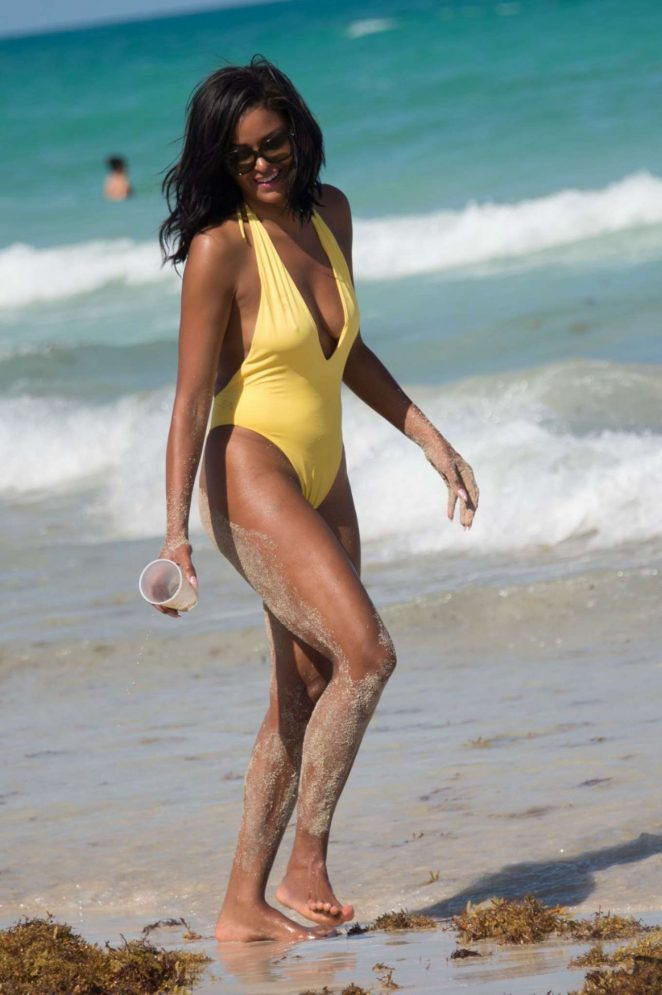 Claudia Jordan in Yellow Swimsuit at a beach in Miami