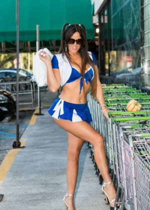 Claudia Romani cheerleader halloween outfit at Publix in South Beach