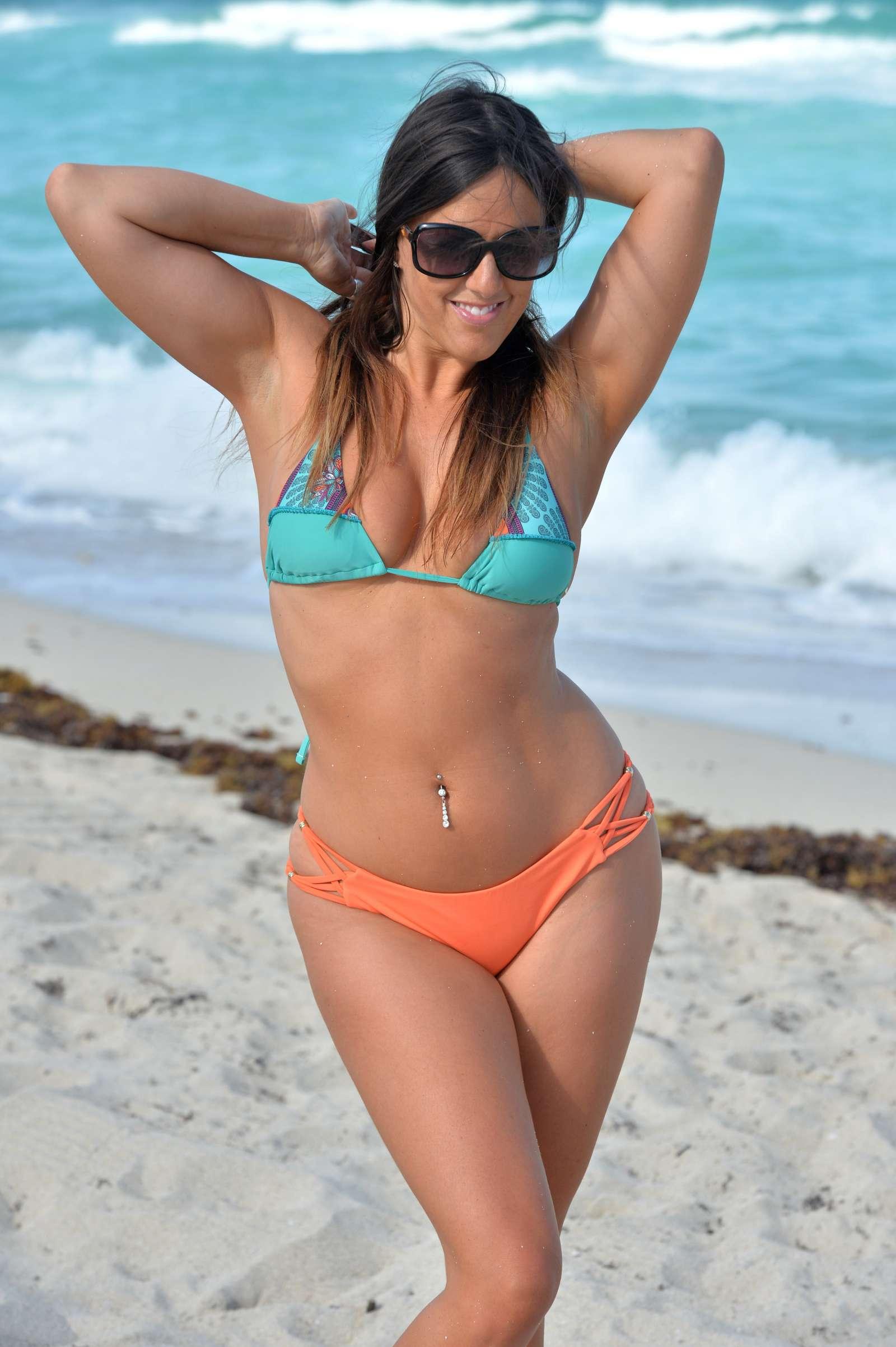 Claudia Romani in a tiny bikini on the beach in Miami