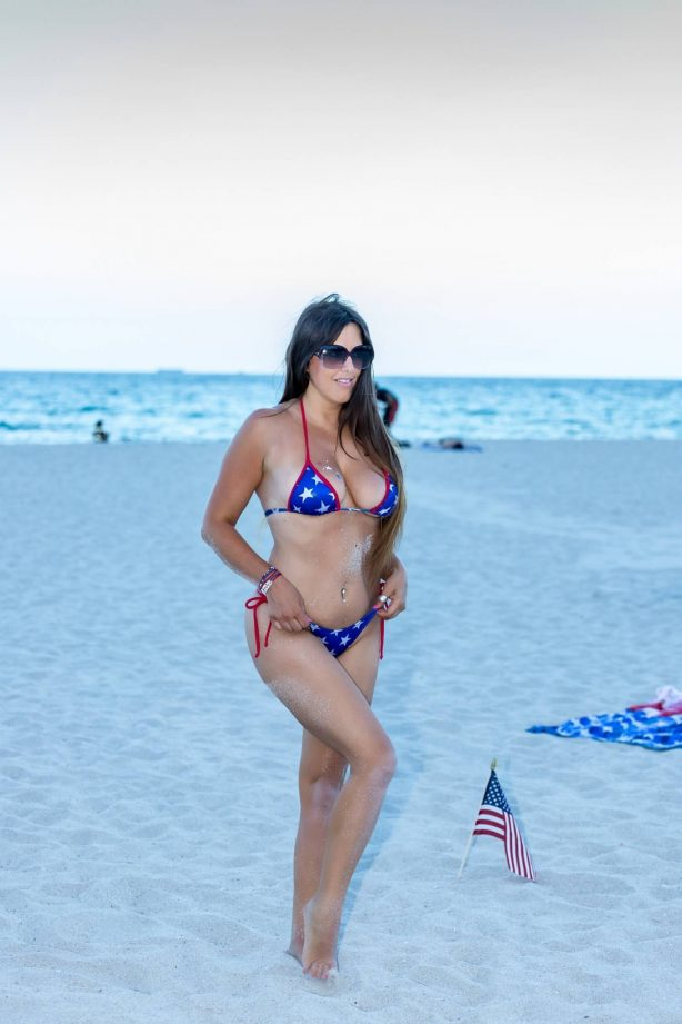 Claudia Romani in Bikini on the beach in Miami