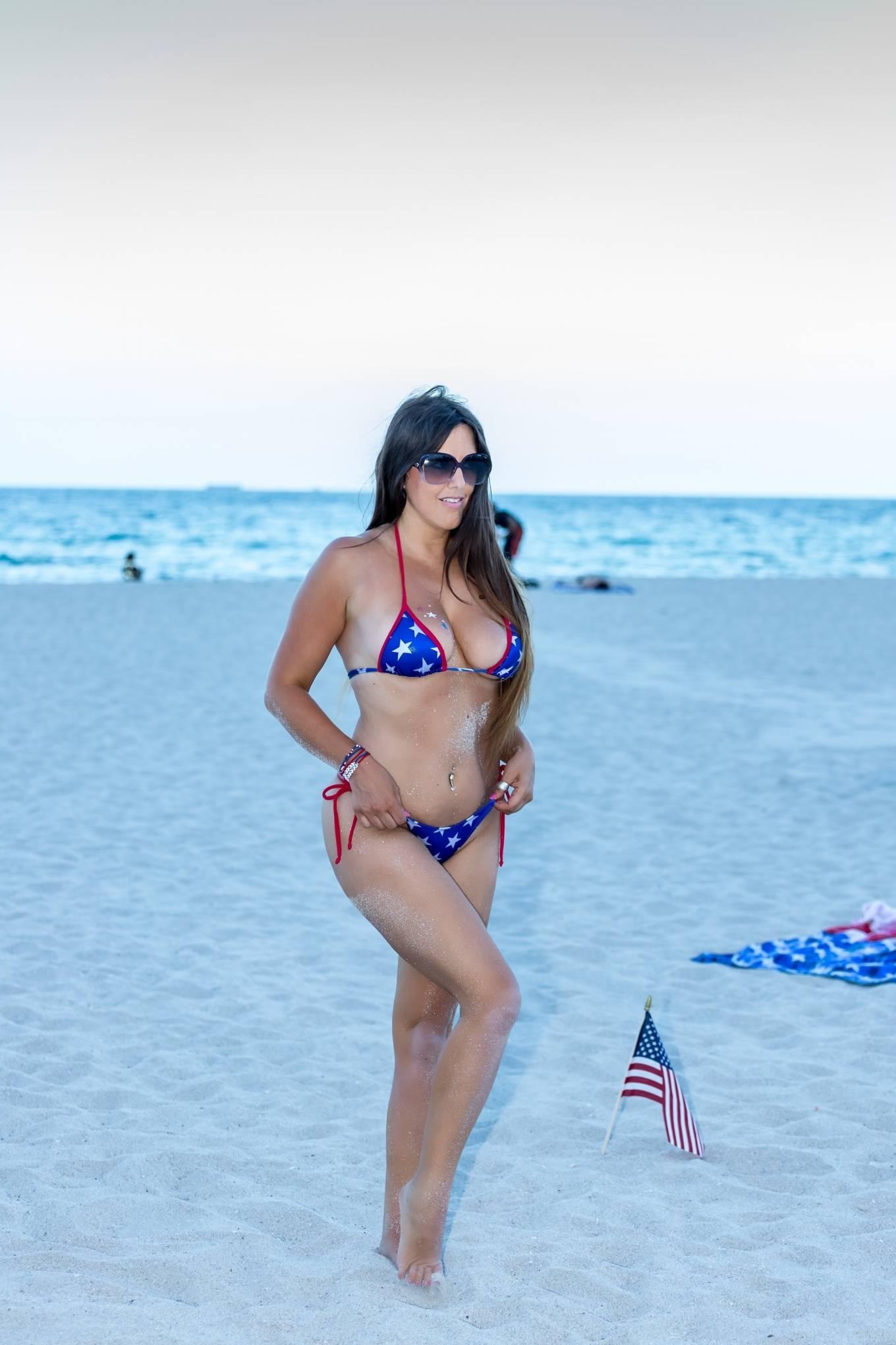 Claudia Romani in Bikini on the beach in Miami