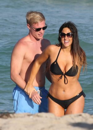 Claudia Romani in Black Bikini at a beach in Miami