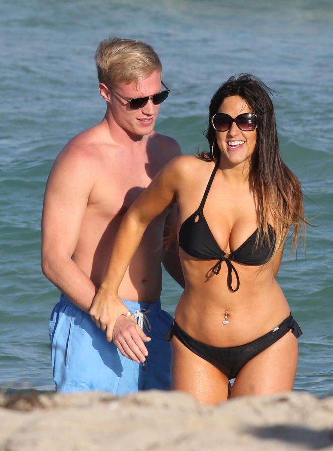 Claudia Romani in Black Bikini at a beach in Miami