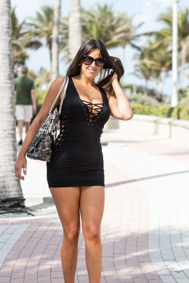 Claudia Romani in Black Mini Dress at South Beach in Miami