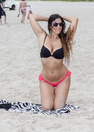 Claudia Romani in Red and Black Bikini in Miami