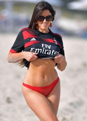 Claudia Romani in Red Bikini Bottoms on the beach in Miami