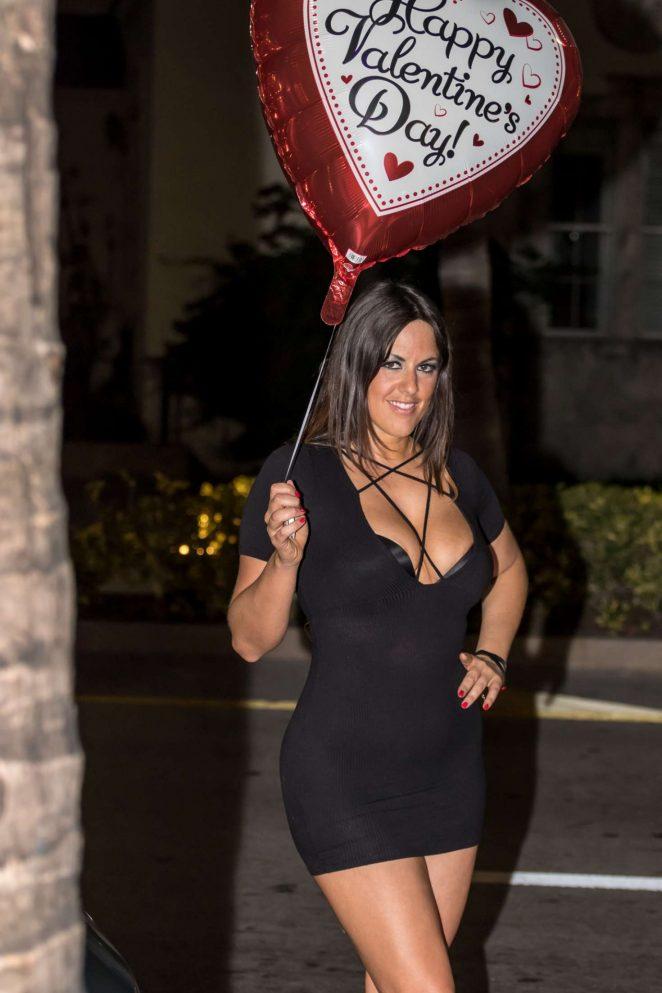 Claudia Romani in short black dress in Miami