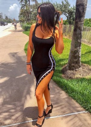 Claudia Romani in Tight Dress walking on Delray Beach