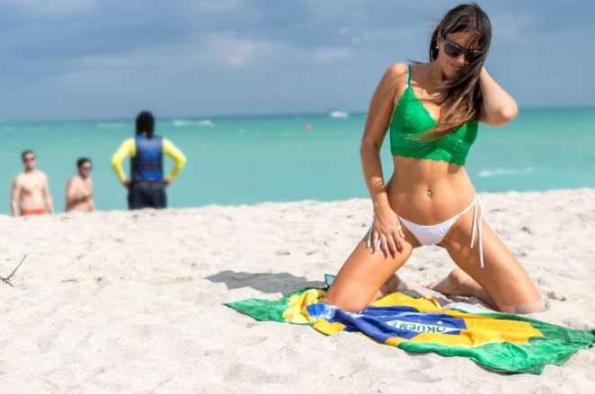 Claudia Romani in White Bikini Bottoms on the beach in Miami