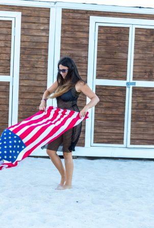Claudia Romani - On her way to the beach in Miami