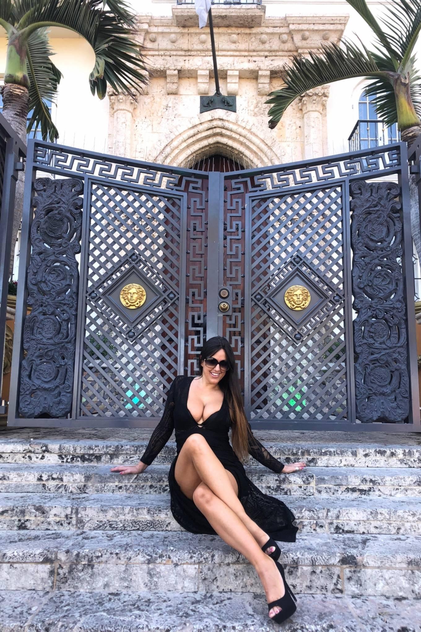 Claudia Romani poses by SoBe landmark