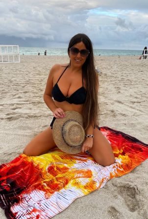 Claudia Romani - Posing at Miami Beach in a bikini
