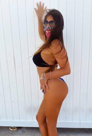 Claudia Romani - Possing in a bikini at Miami Beach