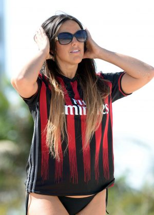 Claudia Romani wearing her AC Milan jersey in Miami