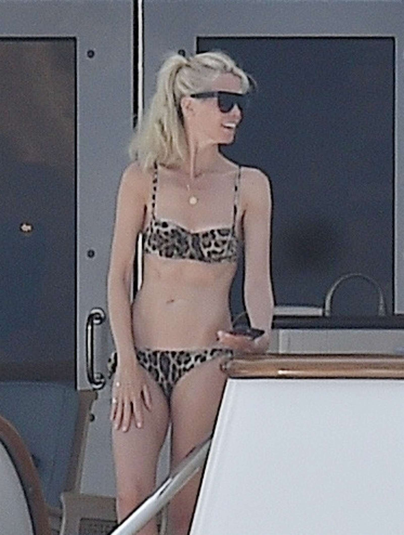 Claudia Schiffer in Animal Print Bikini on a yacht in Portofino