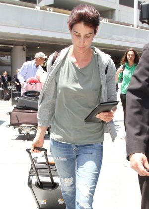 Cobie Smulders in Ripped Jeans at LAX in Los Angeles