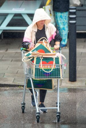 Coleen Rooney - Braves the rain to do grocery shopping in Alderley Edge