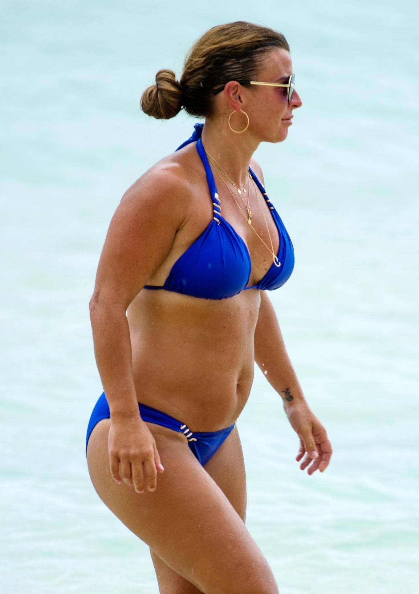 Coleen Rooney - In a royal blue bikini on the beach in Barbados