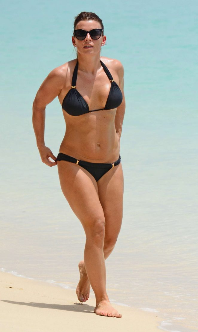 Coleen Rooney in Black Bikini on the beach in Barbados